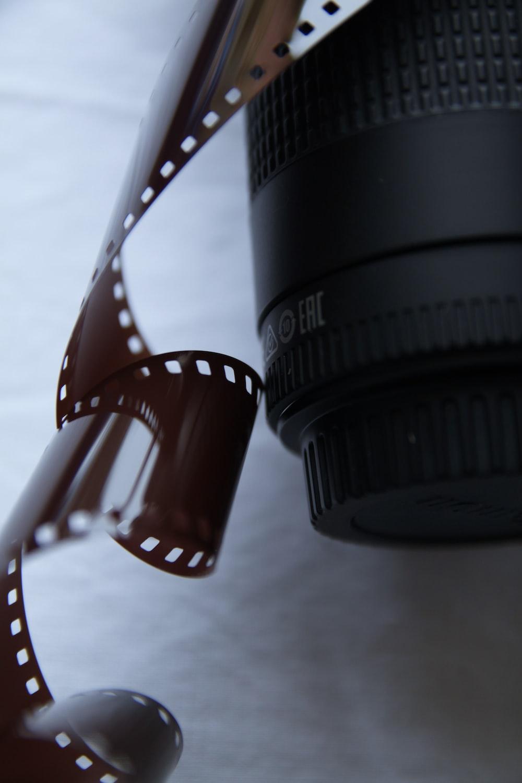 black camera lens on white and red polka dot textile