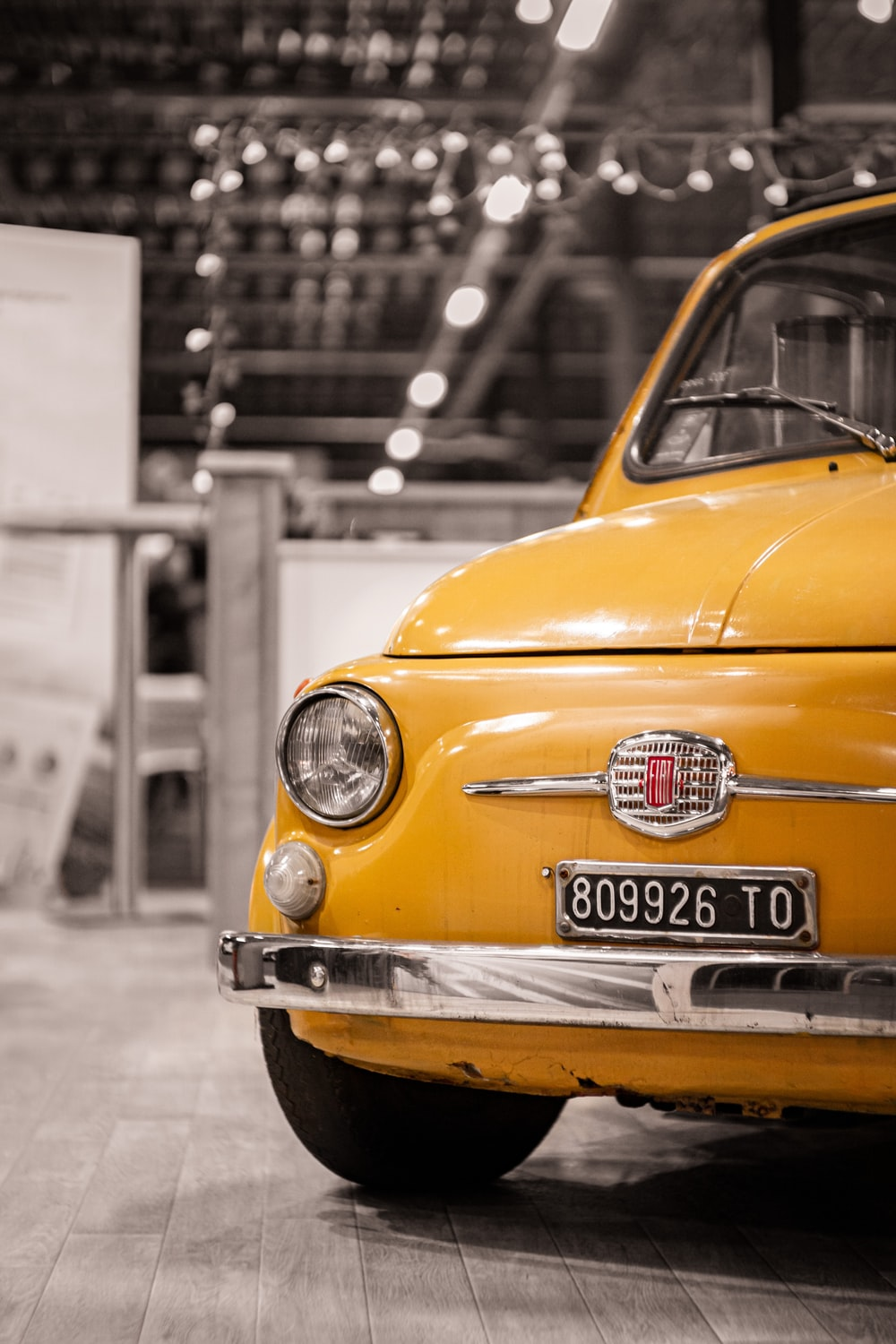 yellow car in grayscale photography
