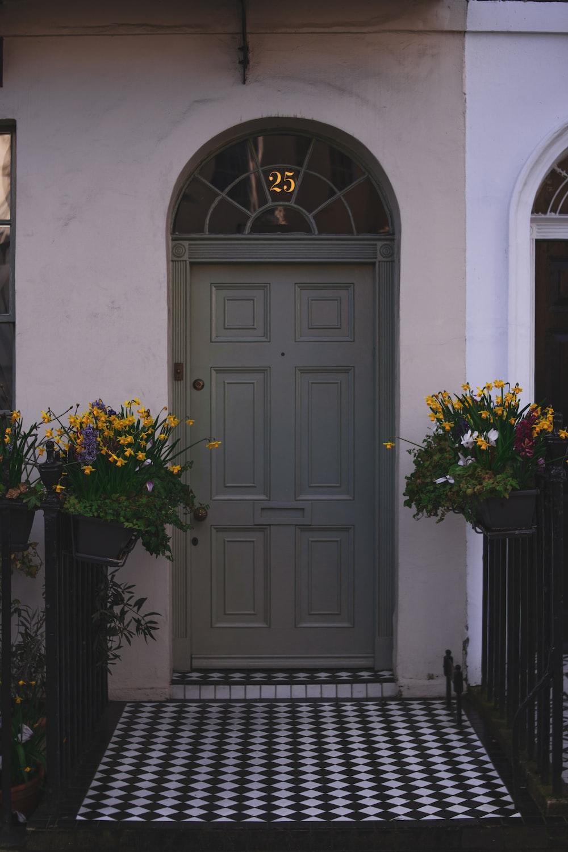 black wooden door with yellow flowers