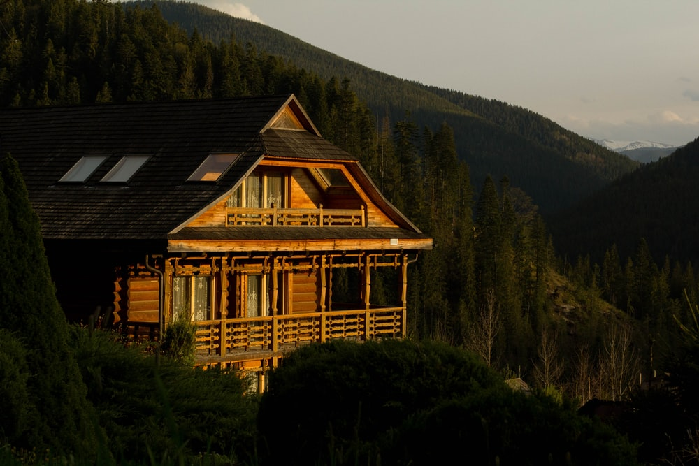 brown wooden house on top of mountain