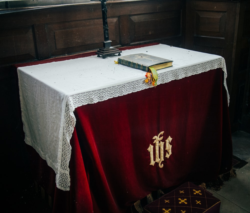 red and gold cross on table