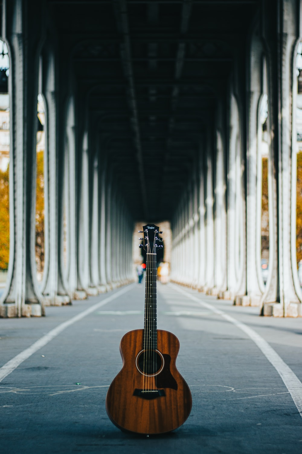 brown acoustic guitar on the street
