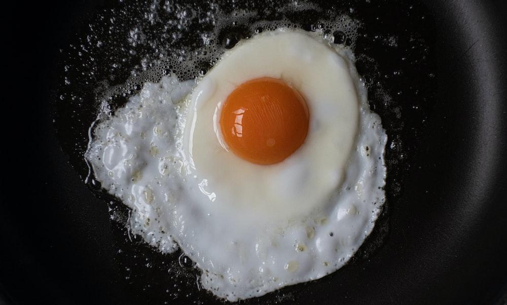 sunny side up egg on white powder