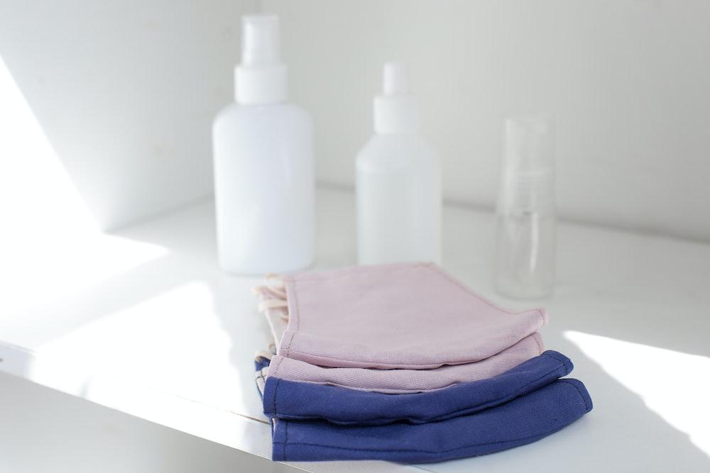 white plastic bottles on white table