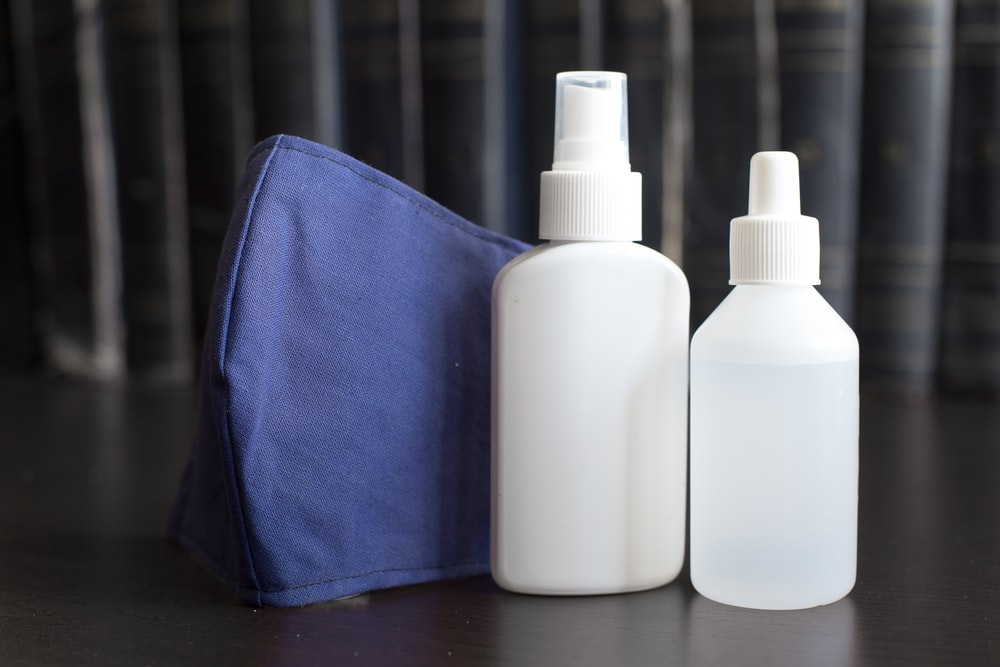 white plastic bottle on blue textile