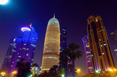 high rise building during night time qatar teams background