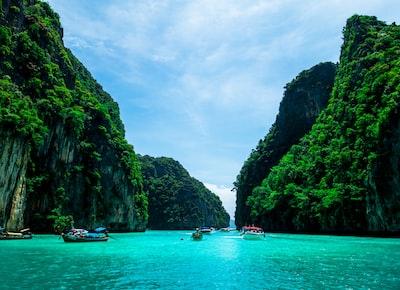 boats on sea near mountain during daytime phuket zoom background