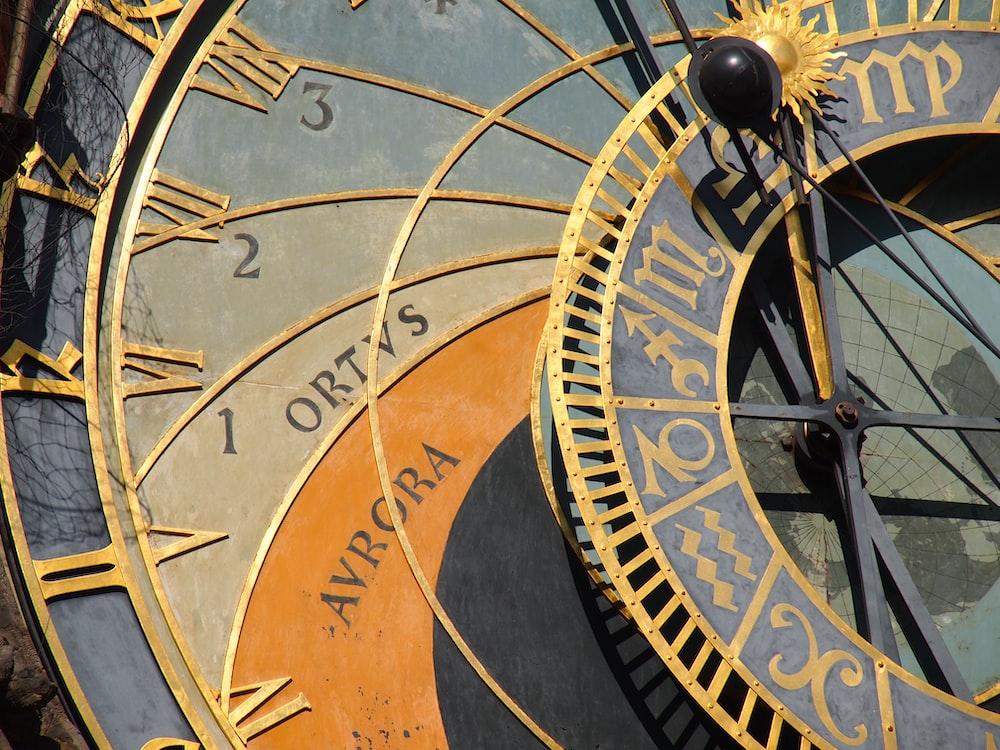 brown and black round analog clock