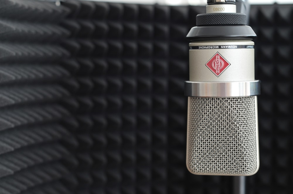 black and gray microphone on black textile