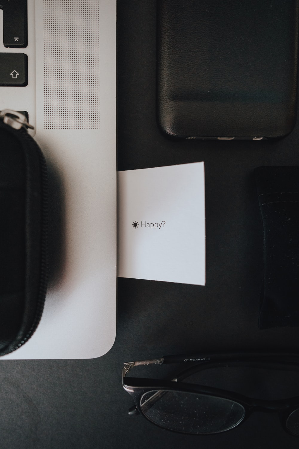 black zip pouch on white table