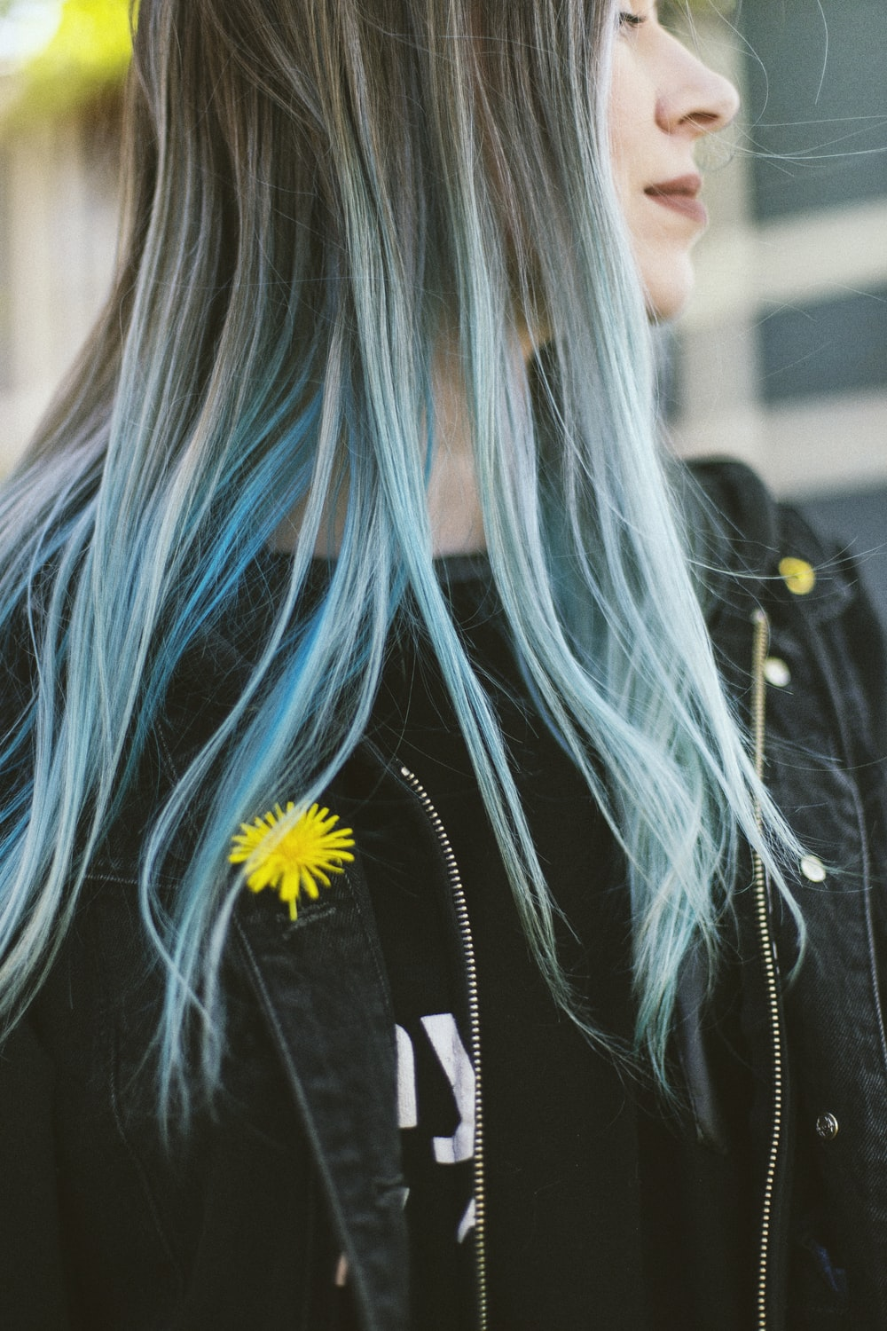 woman in black jacket with blue hair