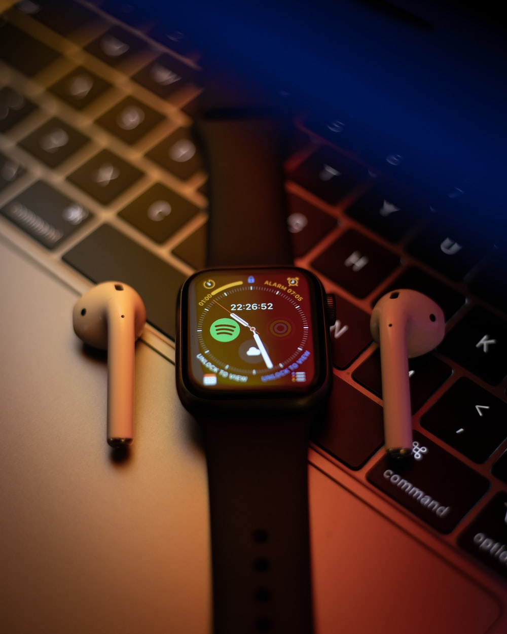 black apple watch with red sport band