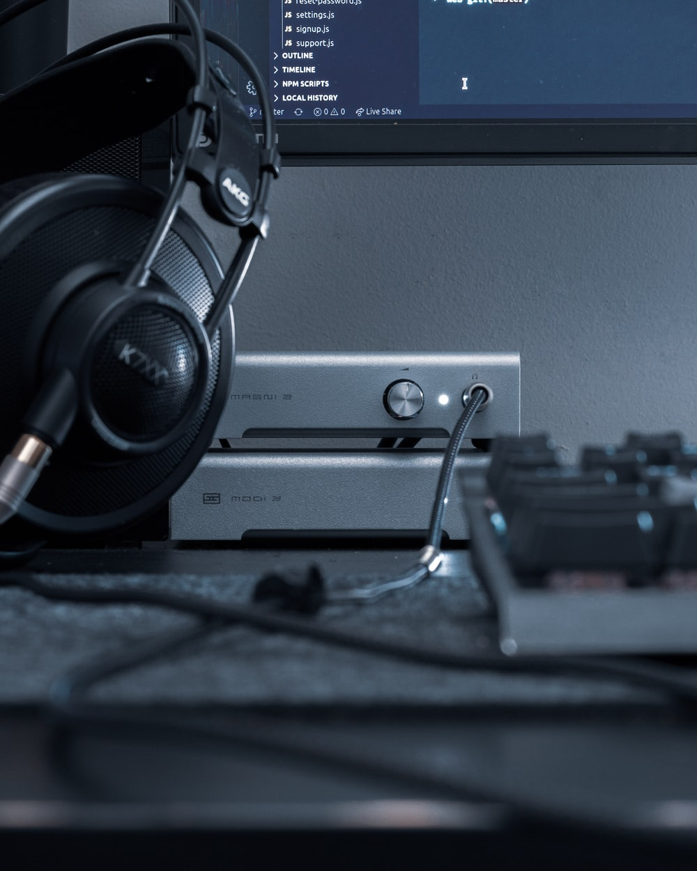black and gray headphones on gray computer tower