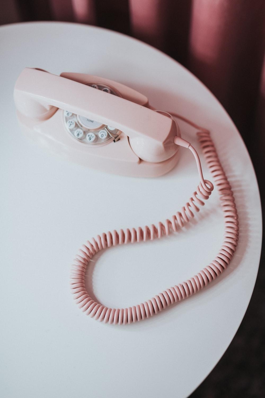 white and pink rotary phone