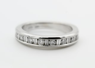 silver and gold round ring