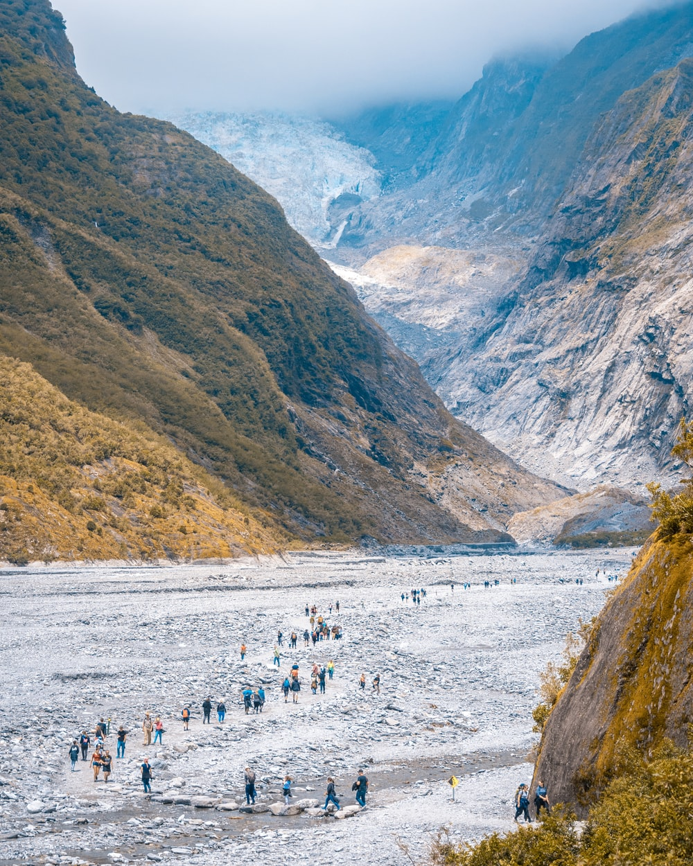 people on white snow covered ground near mountain during daytime