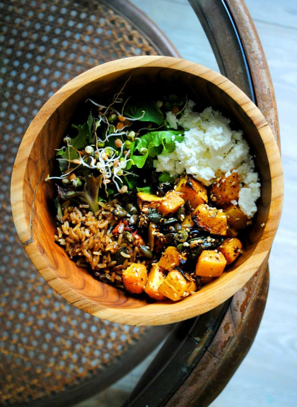cooked food in brown wooden bowl
