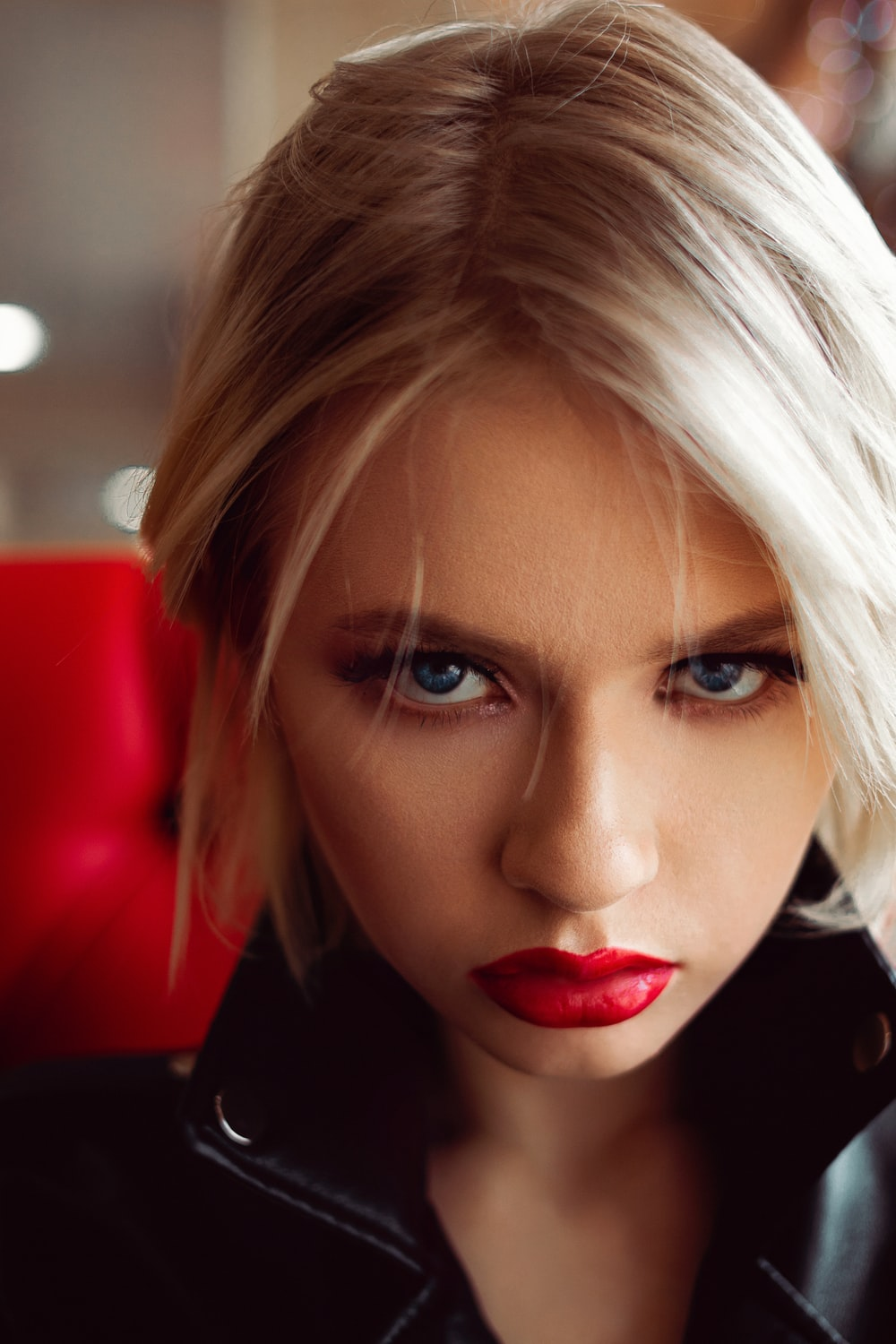 woman with blonde hair wearing red lipstick