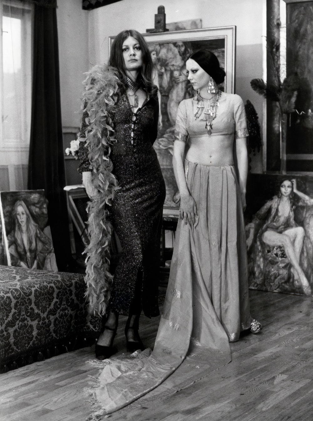 woman in black and white dress standing beside woman in black and white dress