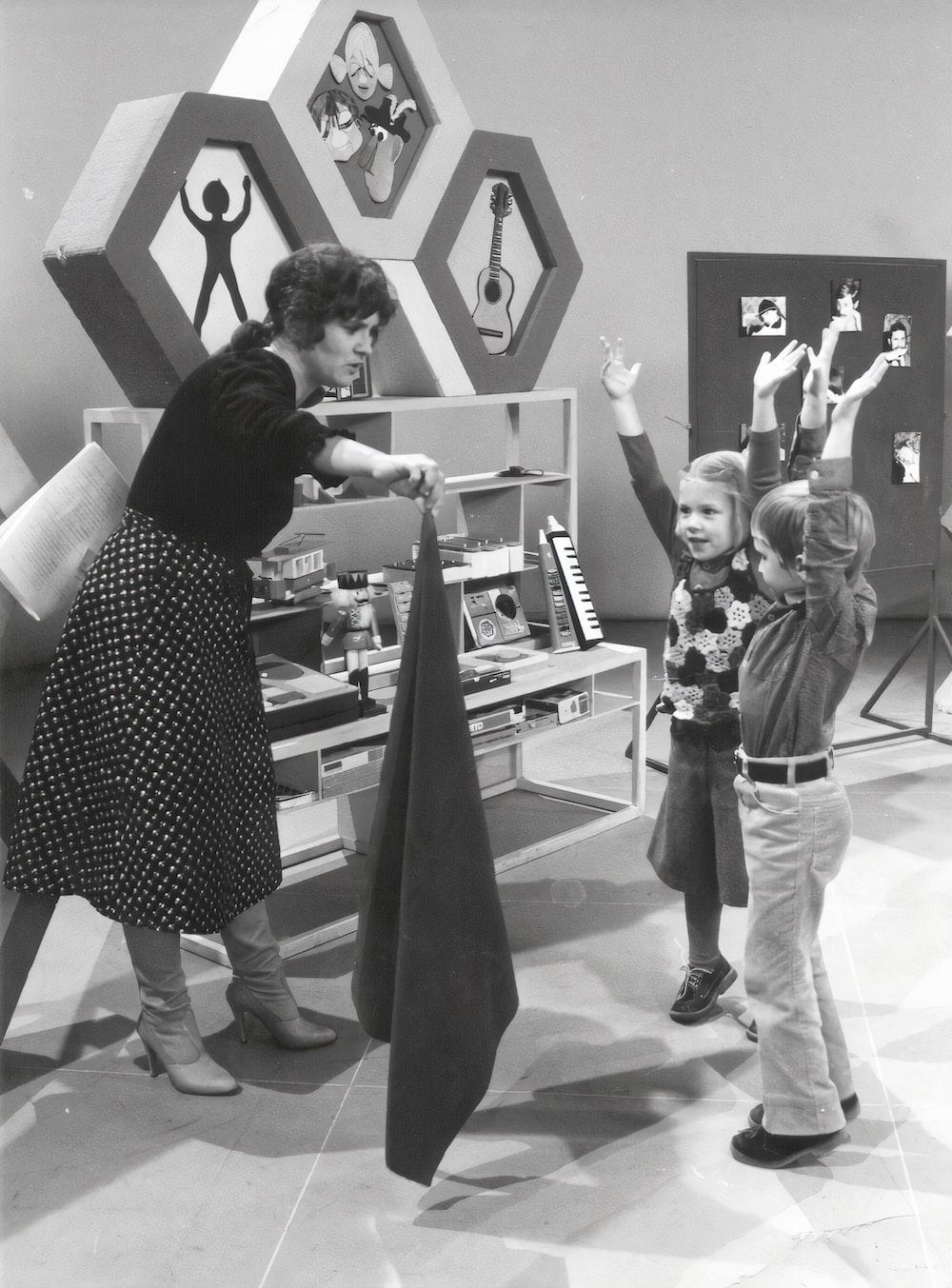 woman in polka dot dress standing beside man in black and white polka dot shirt