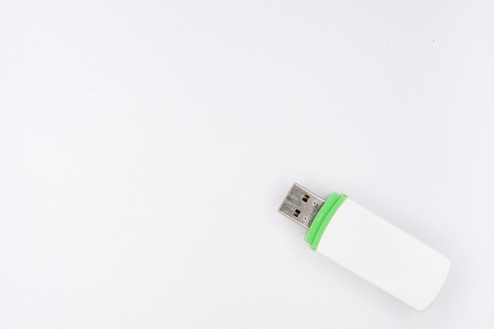 white and green disposable lighter