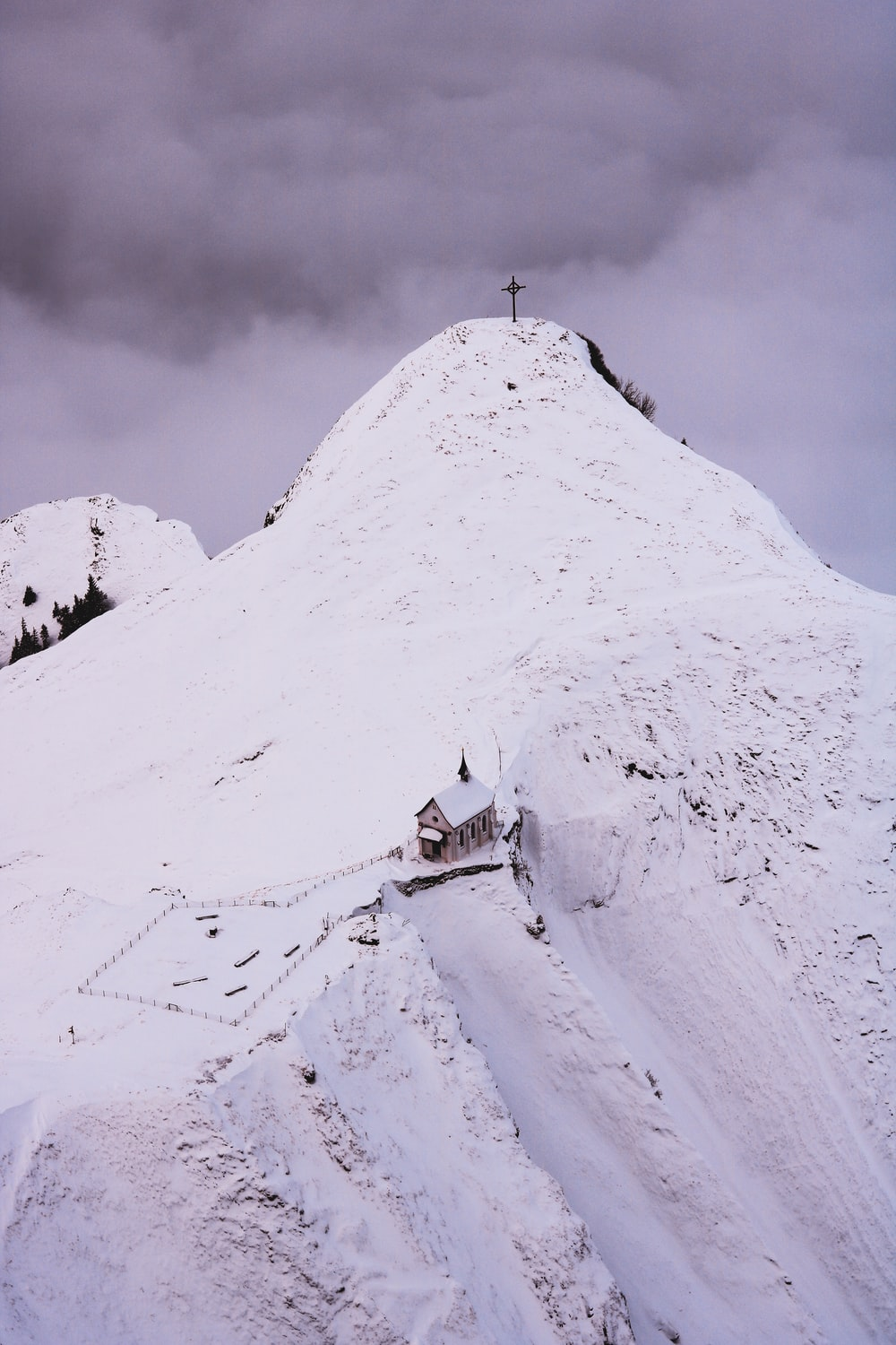white and brown house on snow covered mountain