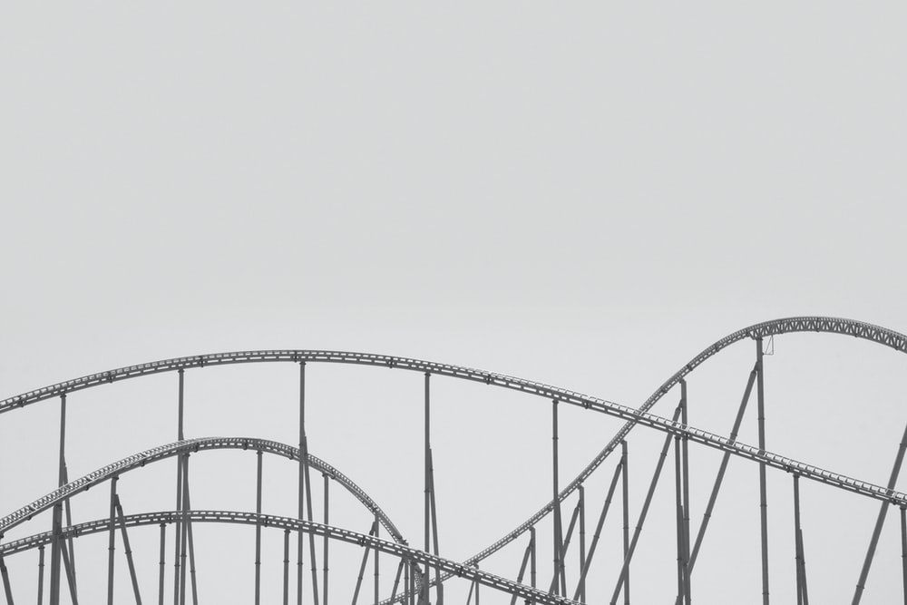 white metal bridge under white sky