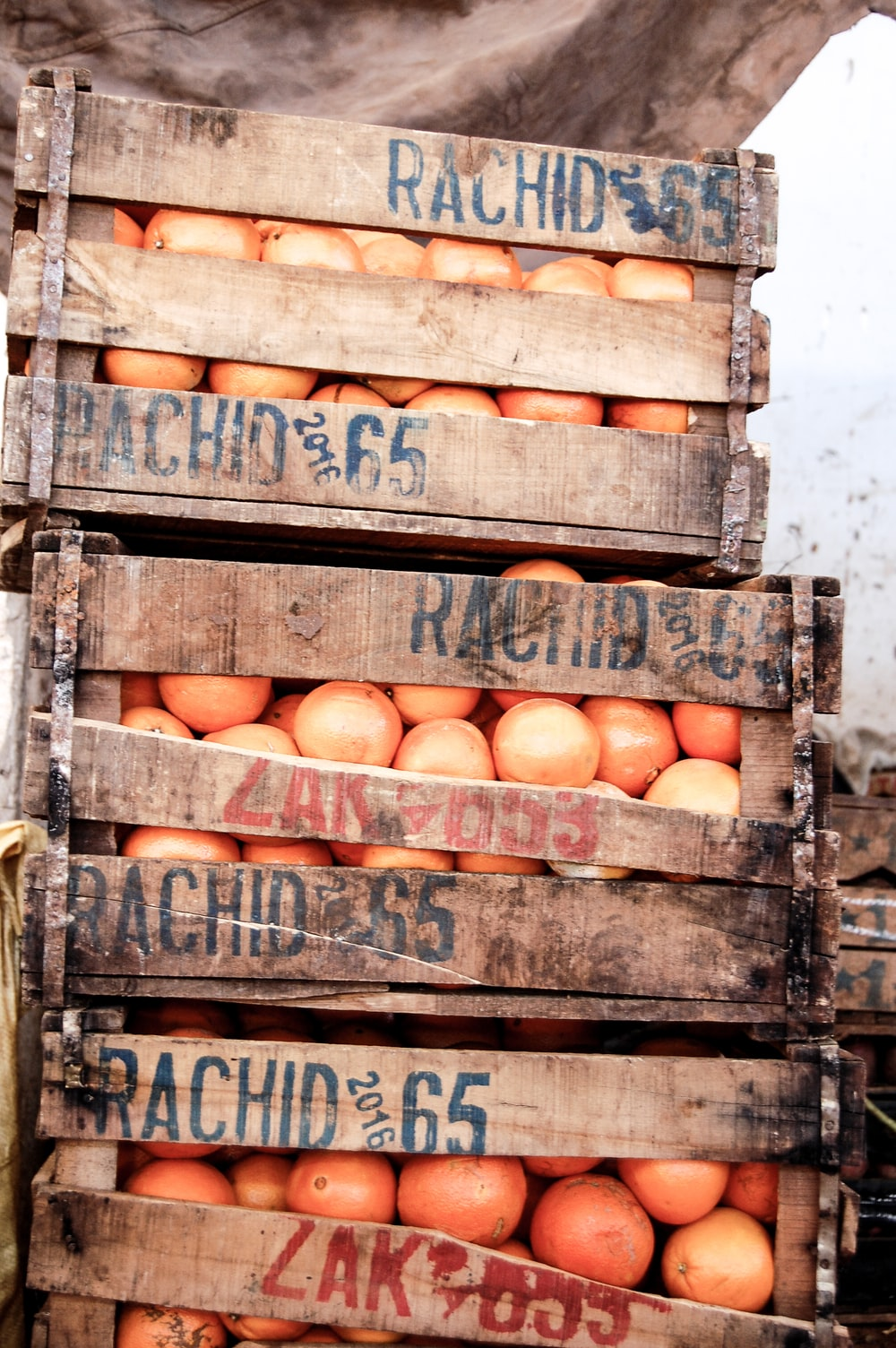 brown wooden crates with brown eggs
