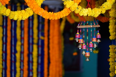 yellow and red hanging decors india teams background