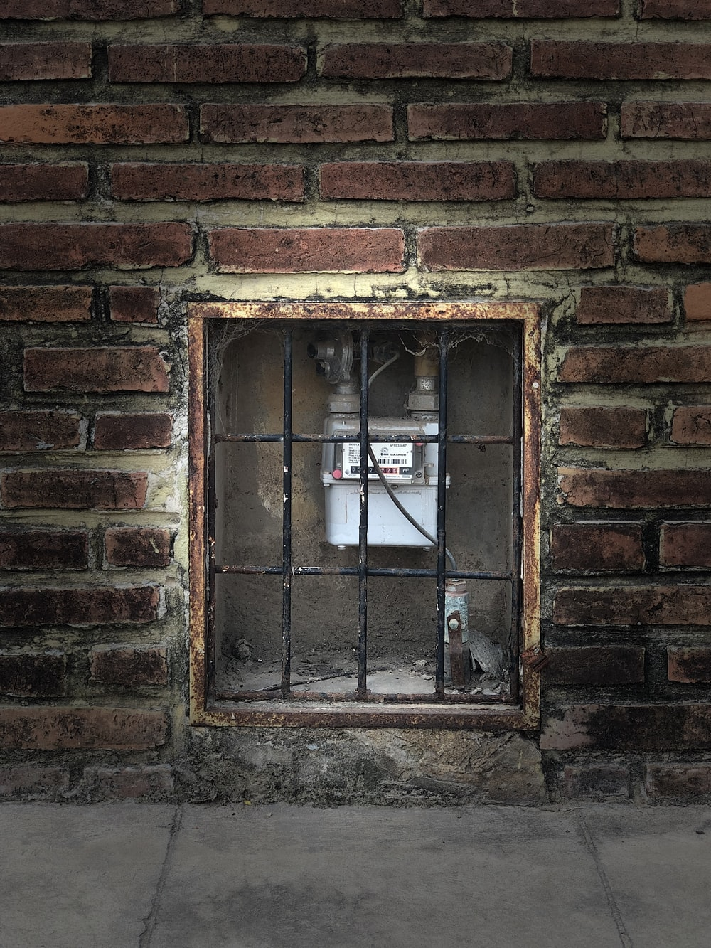 brown brick wall with window