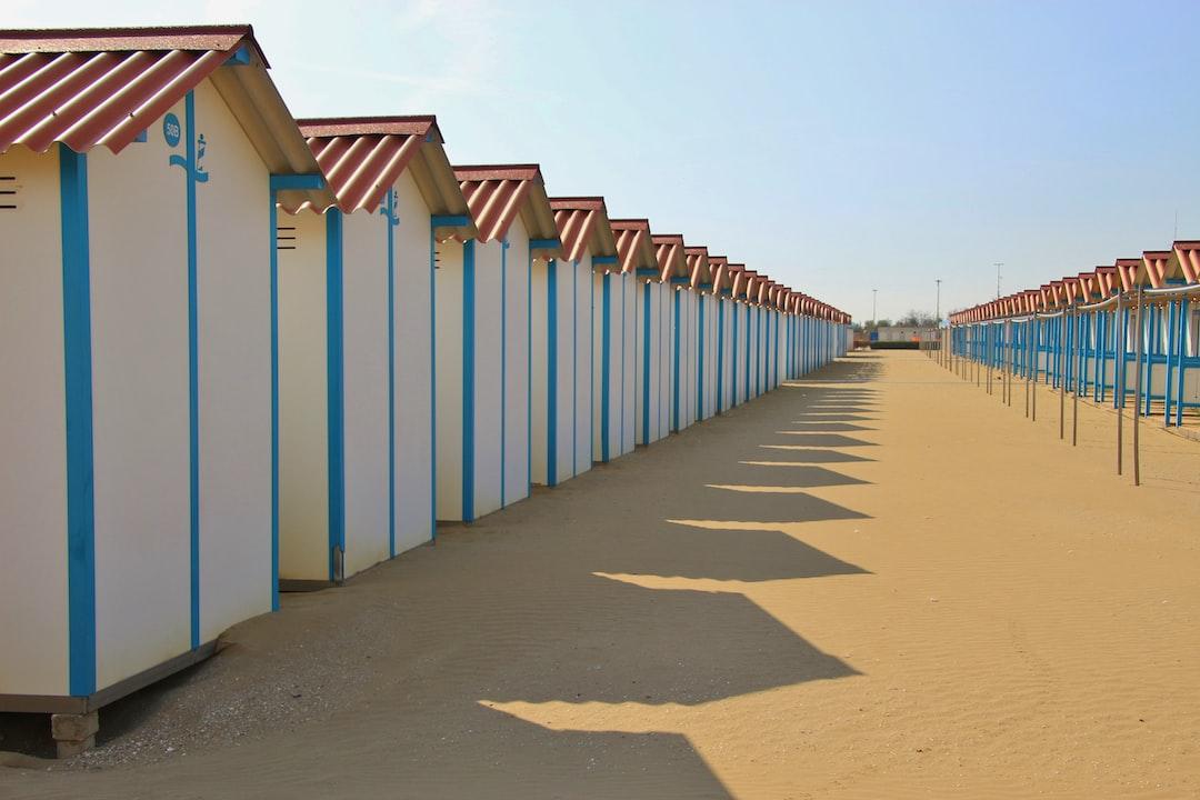 Closed beach huts on the famous Lido beach in Venice, in the low season in April. Lido di Venezia, Italy, Europe.