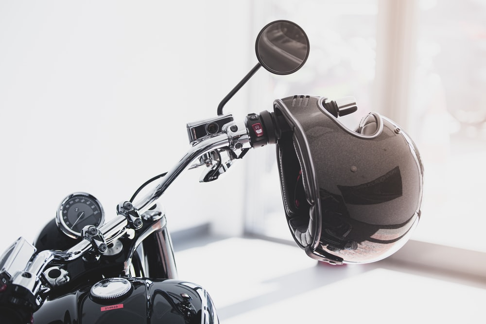 red and black motorcycle in a white room