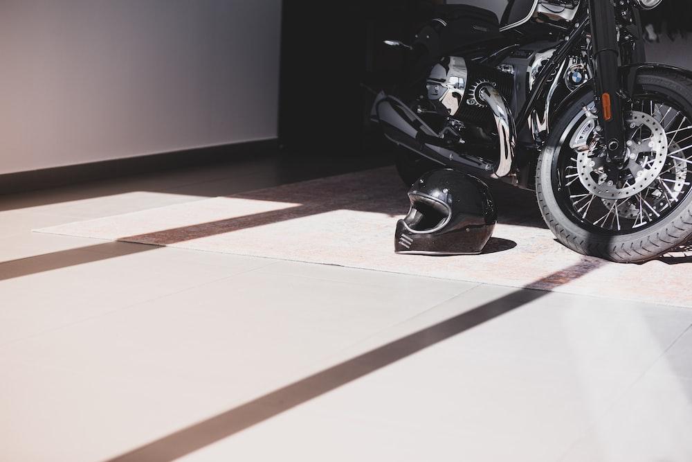 black motorcycle parked on brown floor