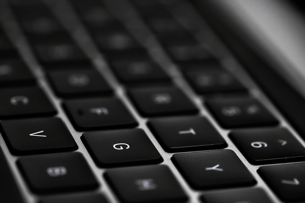 black and silver laptop computer