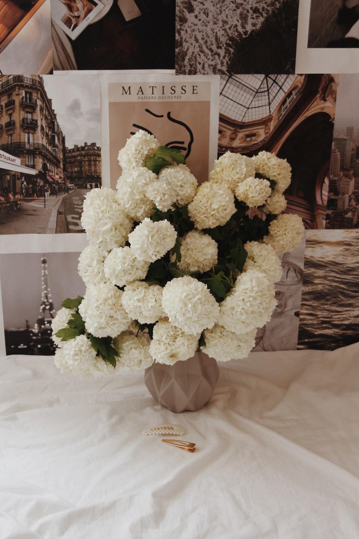 white flowers on white textile