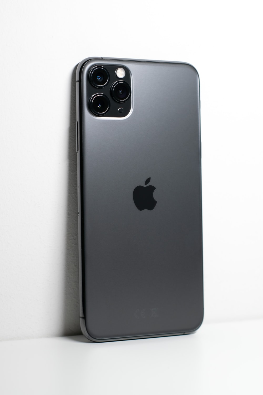 black iphone 7 plus on white surface