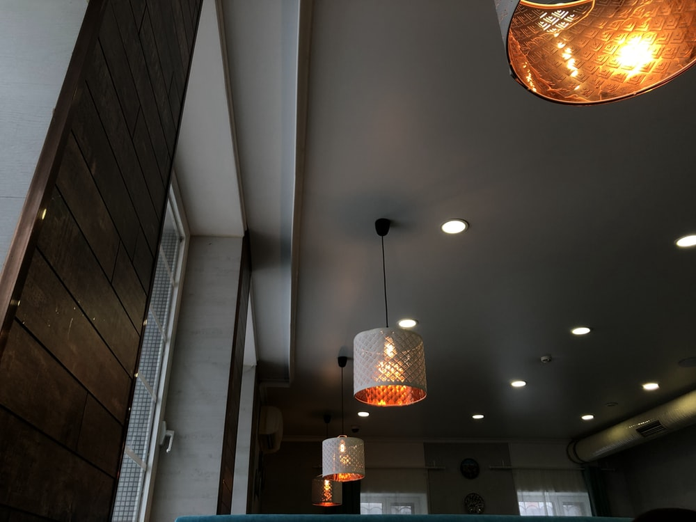 brown pendant lamp turned on in room