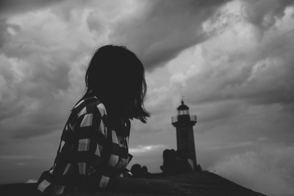 grayscale photo of woman in stripe shirt