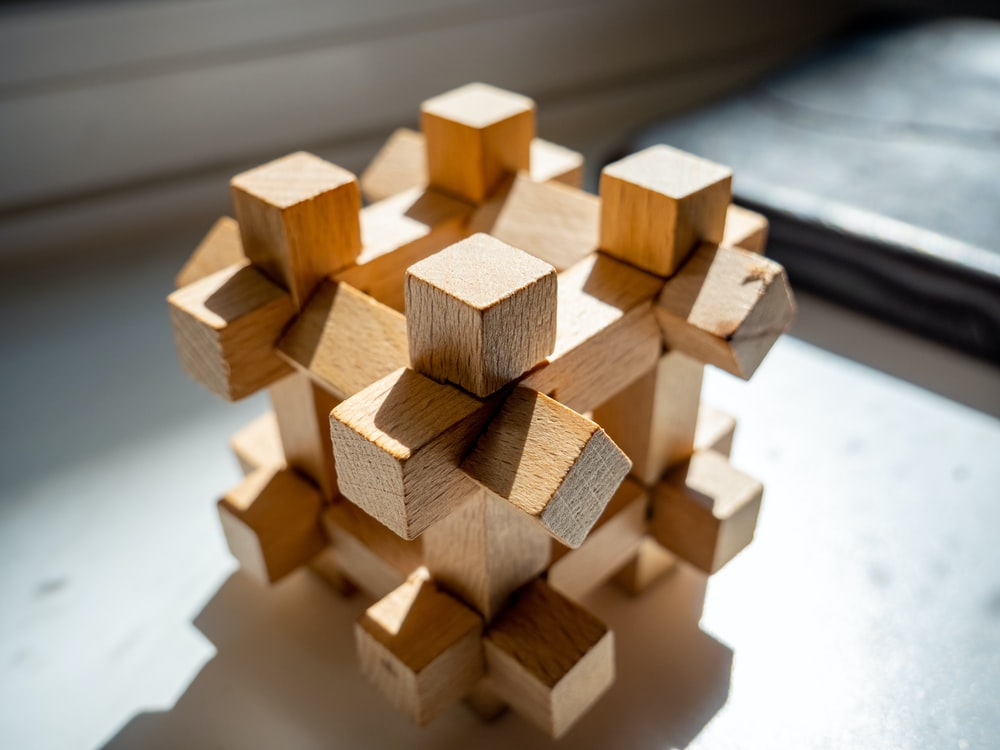 brown wooden blocks on black wooden table