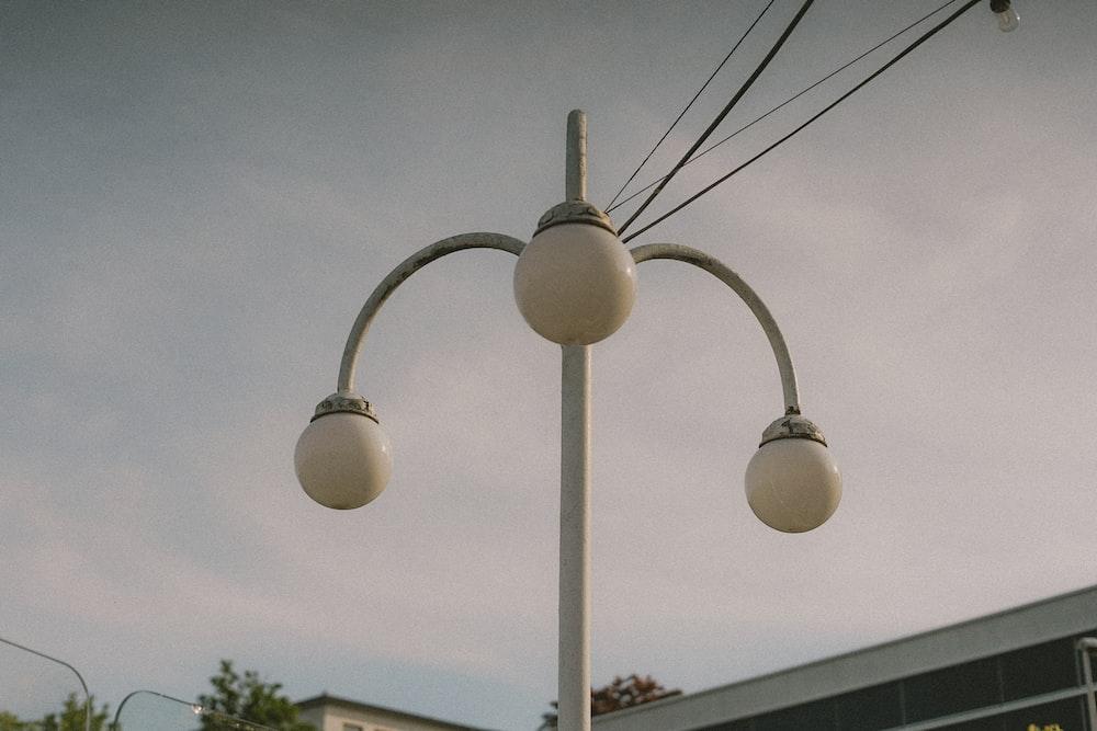 white light bulb turned on during daytime