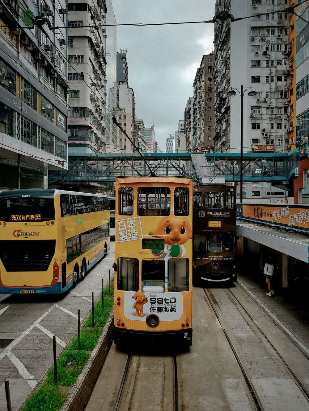 yellow and white tram on road during daytime
