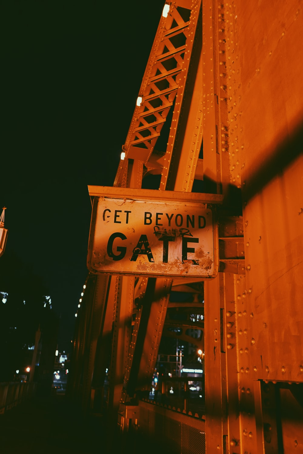 brown wooden signage during night time