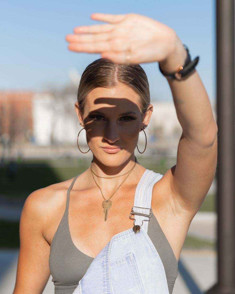 woman in gray tank top wearing black sunglasses