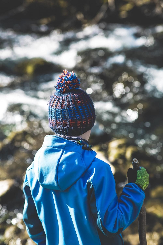 person in blue jacket wearing knit cap