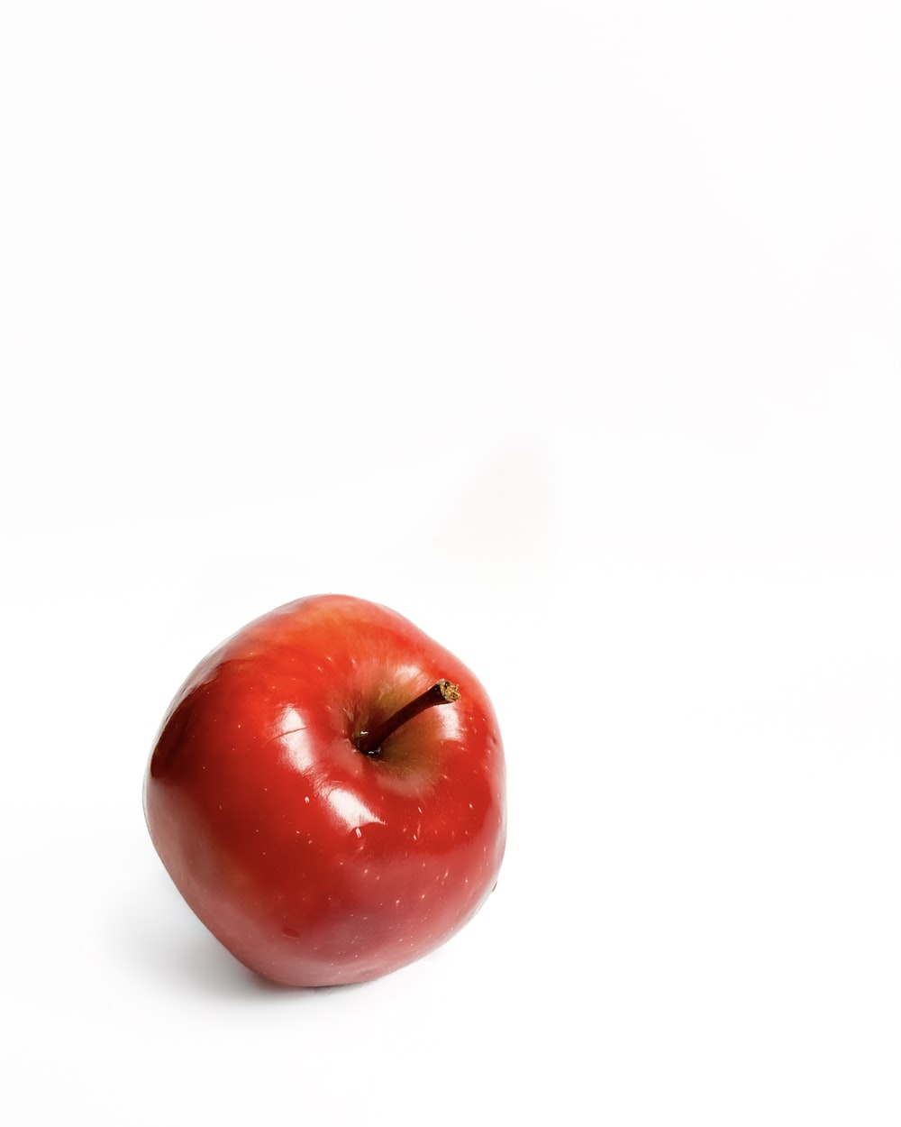 red apple on white surface