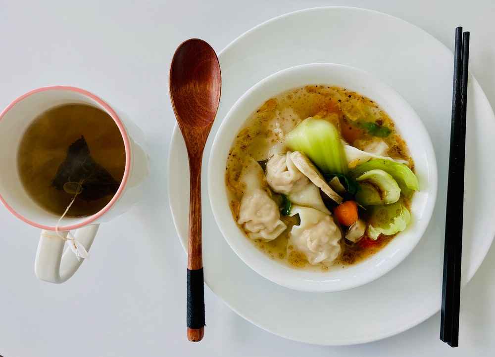 soup with vegetables in white ceramic bowl