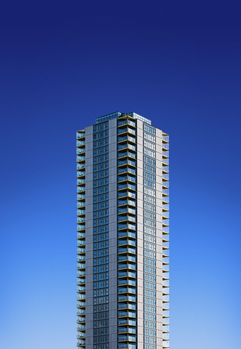 white and blue high rise building under blue sky during daytime