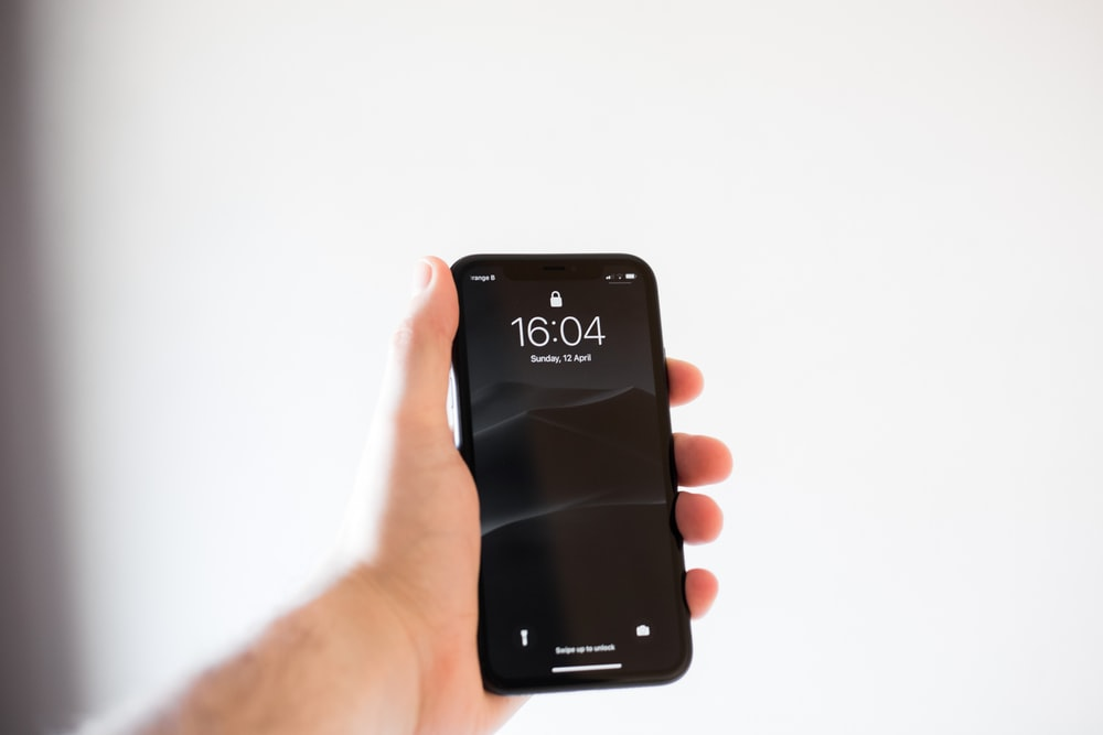 person holding black android smartphone