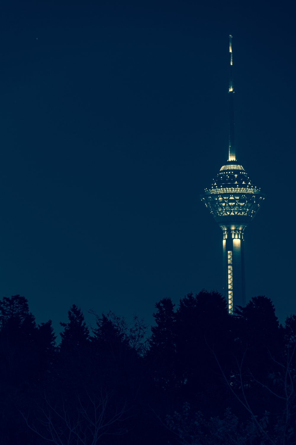 white and green tower during night time