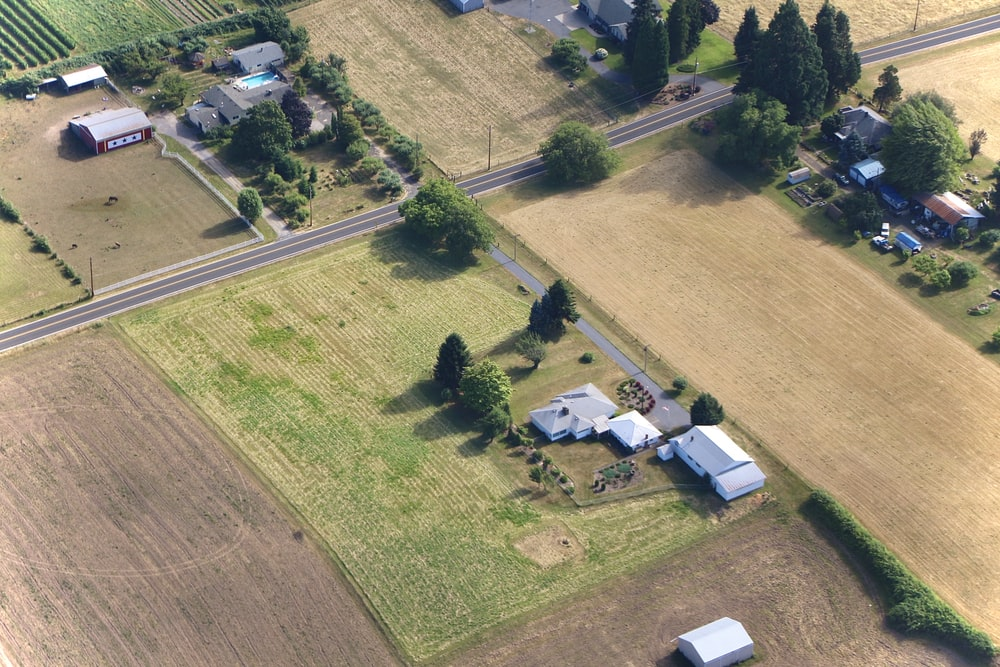 white van parked on green grass field during daytime